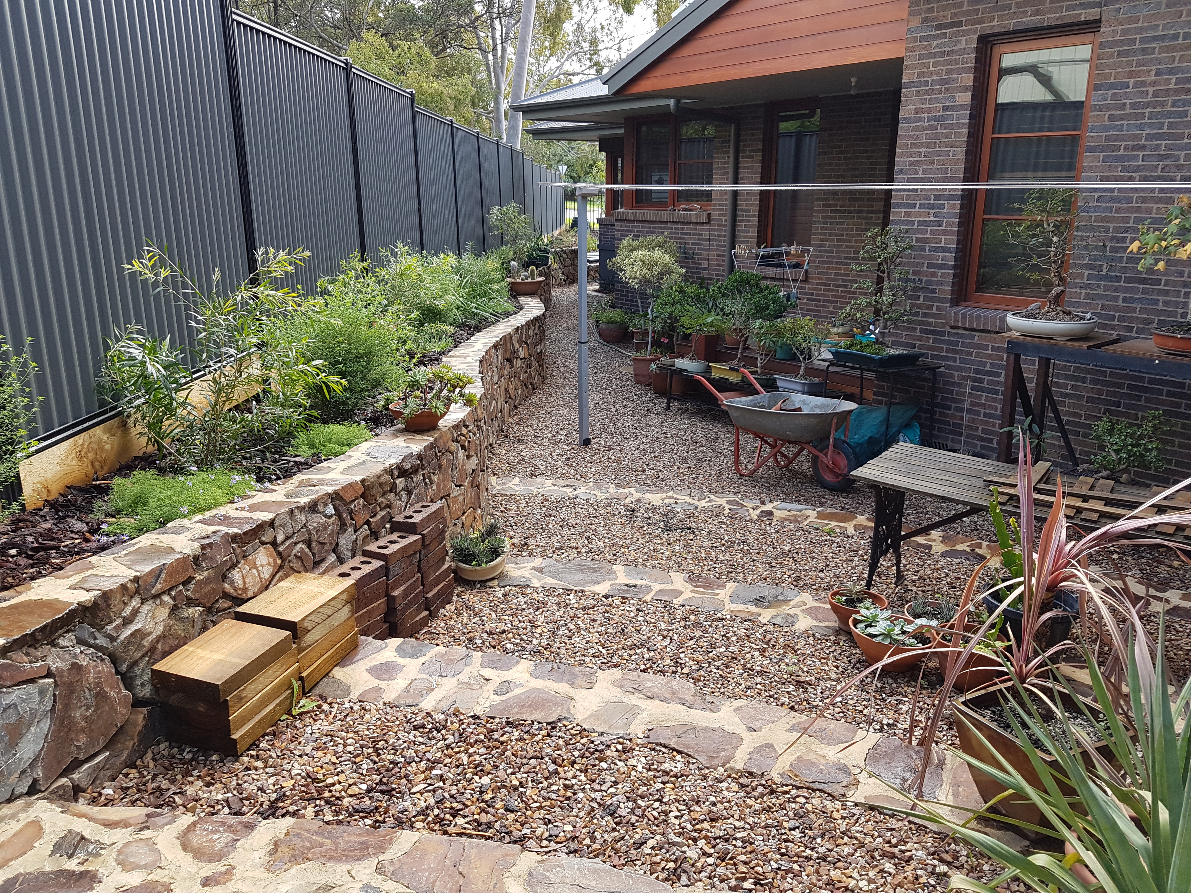 Sideway, utilily area, coldstream stone retaining wall and steps, 20mm crushed sandstone path