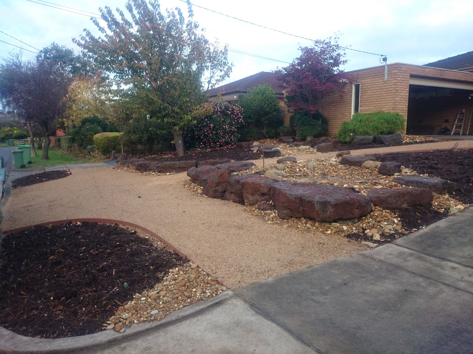 Colac rock for retaining, compacted crushed sandstone, River stones.