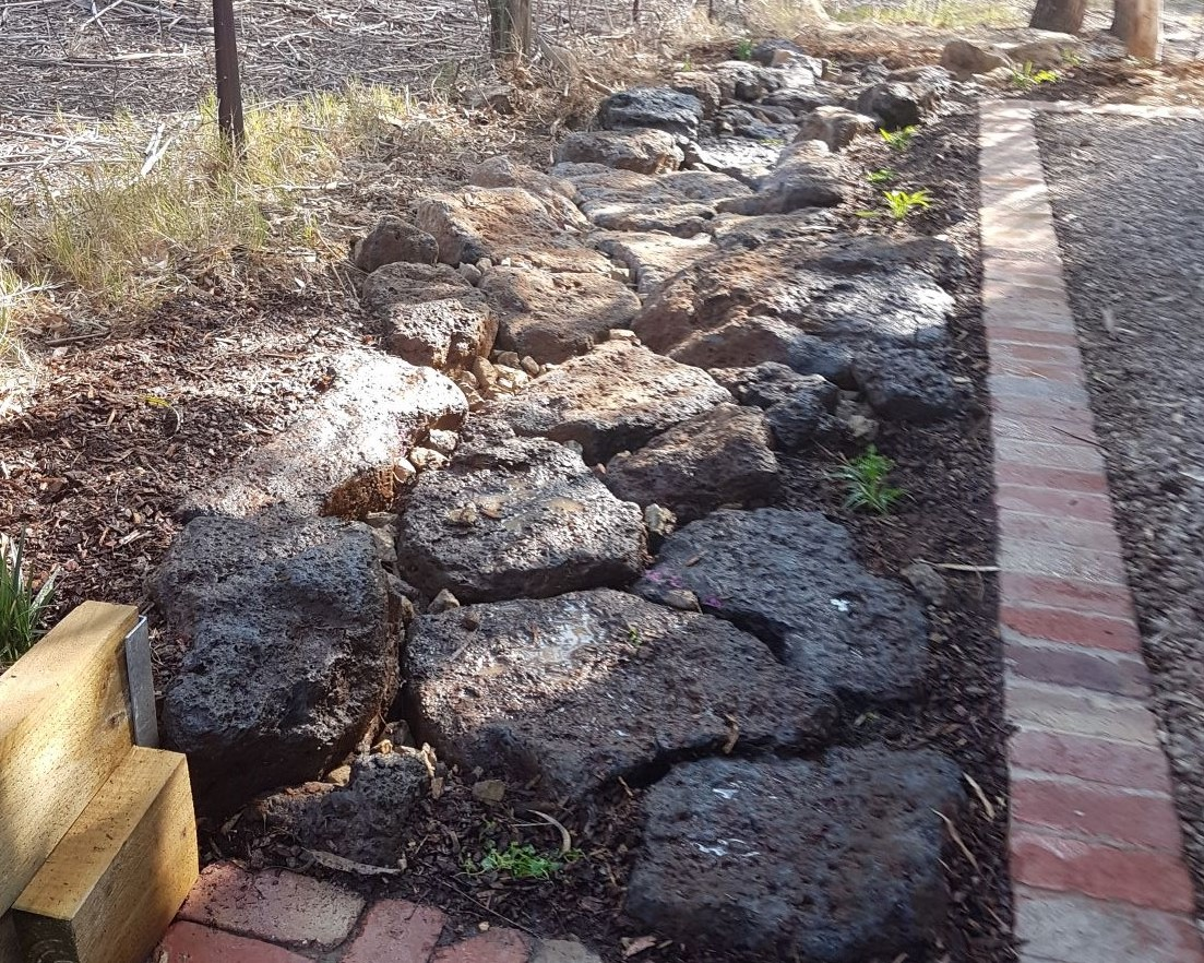 Colac rock placed for dry creek bed, second hand red bricks, native garden, Eltham garden, Drainage to direct excess water into the garden, native plants