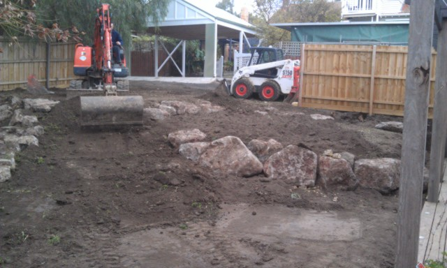 Colac rock for retaining, Terraced garden, Ivanhoe garden, Excurvator rock placement, Bobcat rock placement.