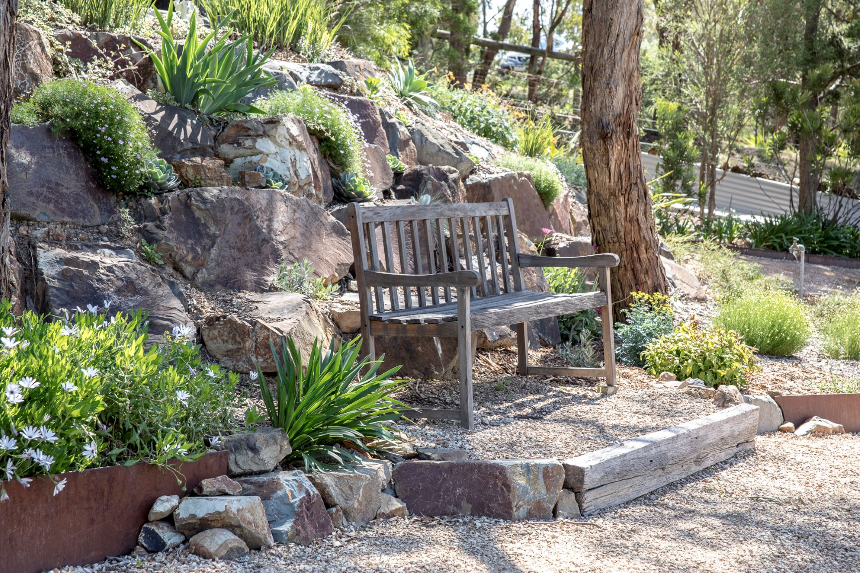 Natural Rock place in sloping bank, planted rock bank, Coldstream rock.