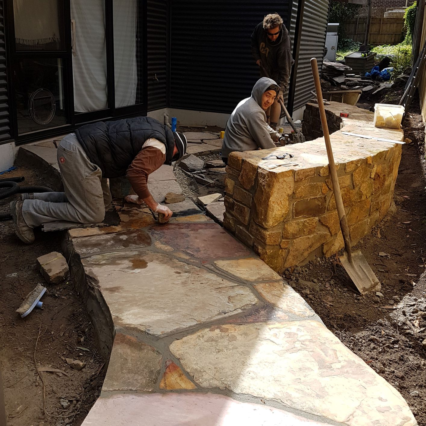 Crazy paving is usually natural stone,  Sandstone Stone, Coldstream stone seat, Courtyard garden