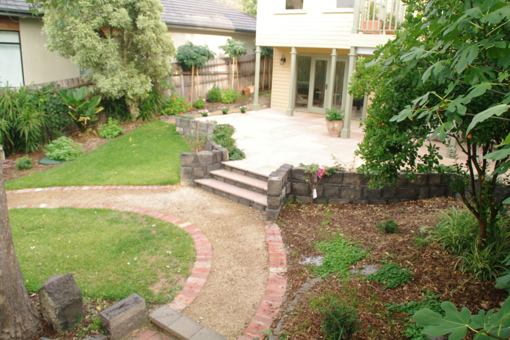 Garden path, rear of the propery garage,   Lawn, Garden path, Secondhand red brick edging, garden beds surrey Hills back garden,  Travertine stone pavers