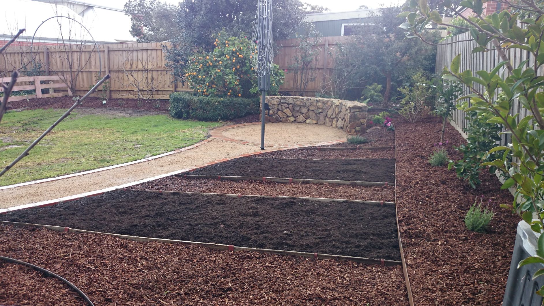 Garden beds, Area for growing Veggies, a Cold stream stone seat, crushed sandstone pathways edged with Red bricks.