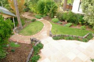 Looking down, Lawn, Garden path, half circular paving, garden beds surrey Hills back garden,  Travertine stone paver