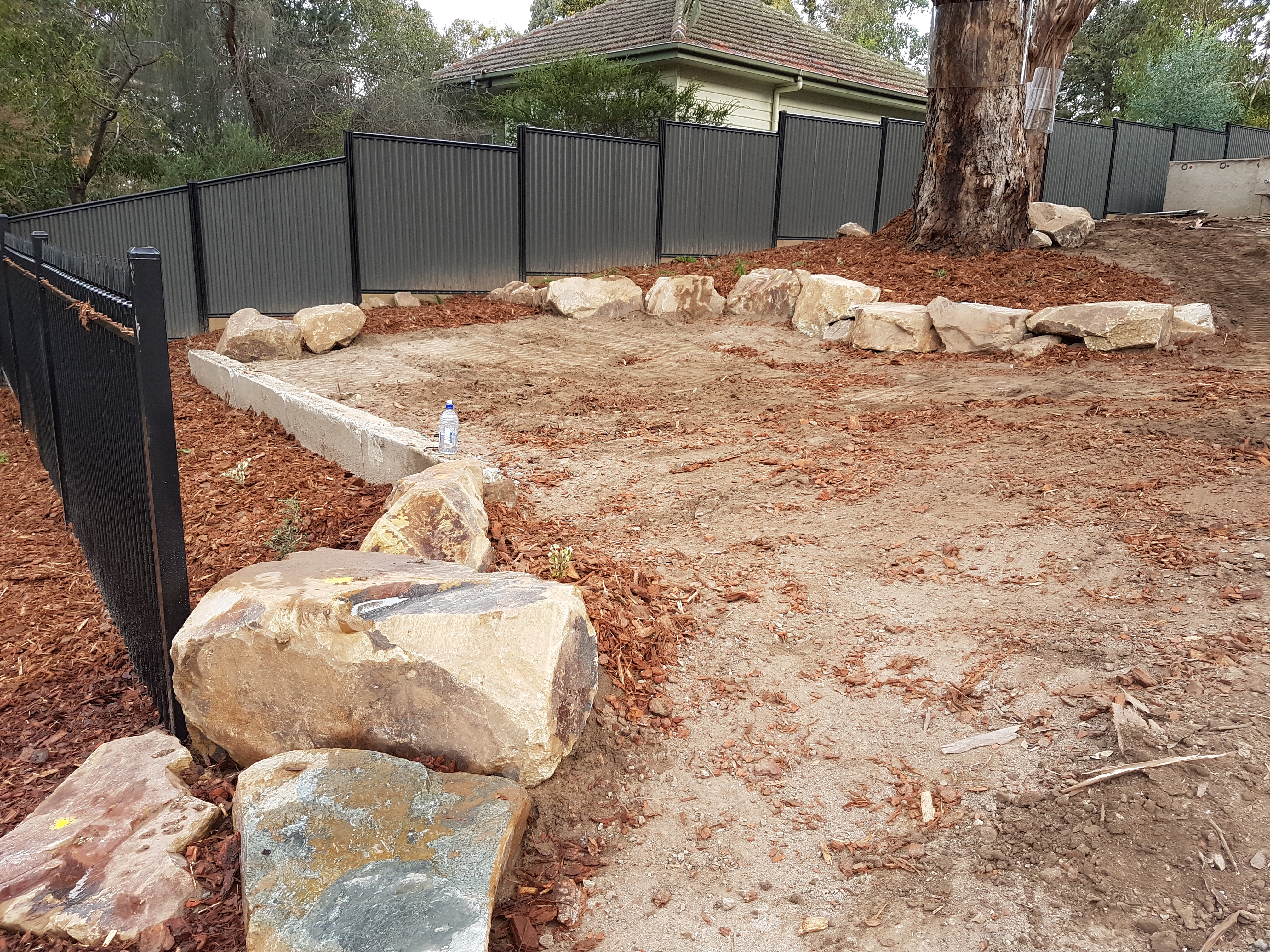 Rock placement for retaining around parking bay
