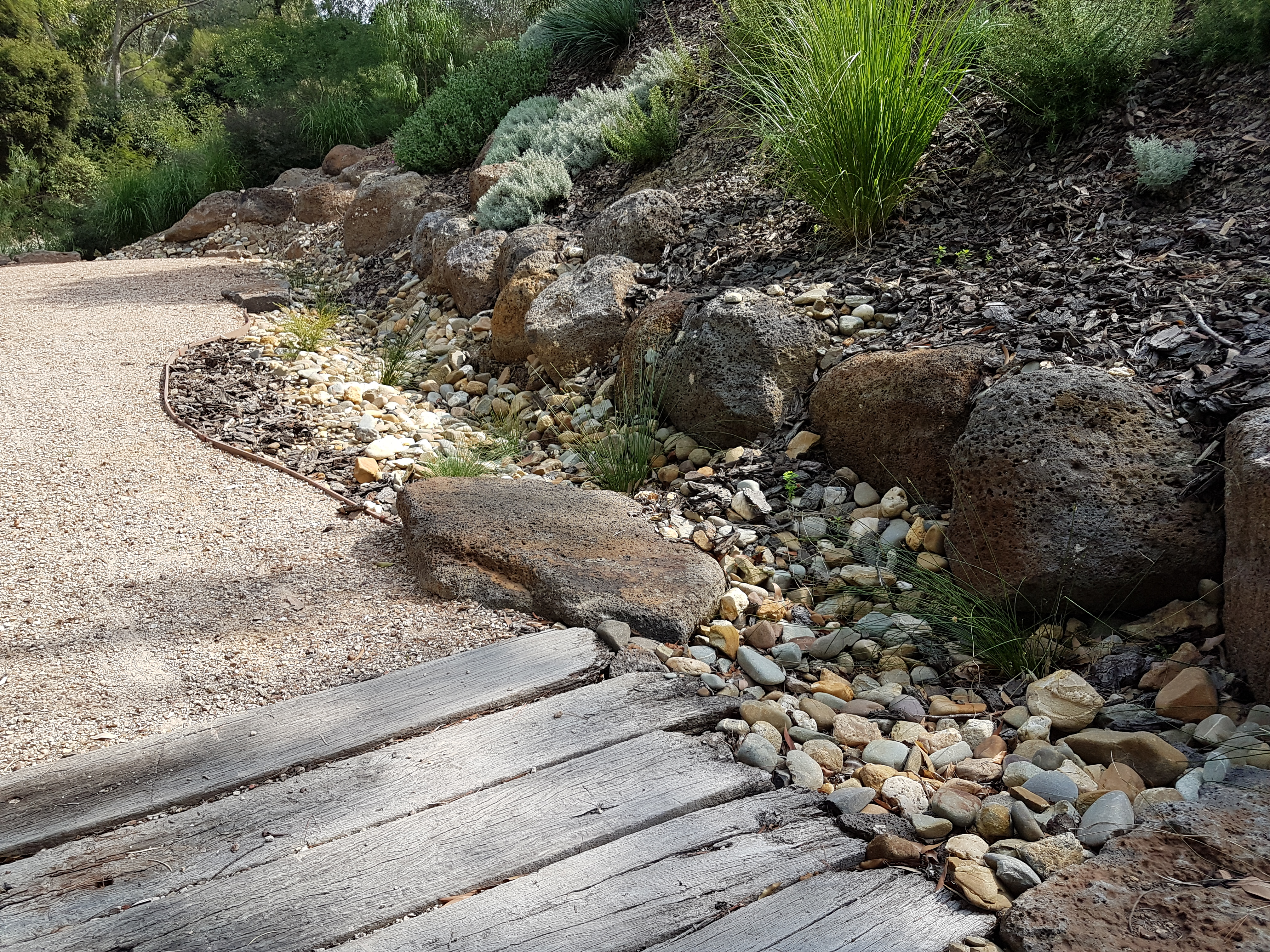 timber bridge is for drainage, Rocks for reatining, compacted toppings.