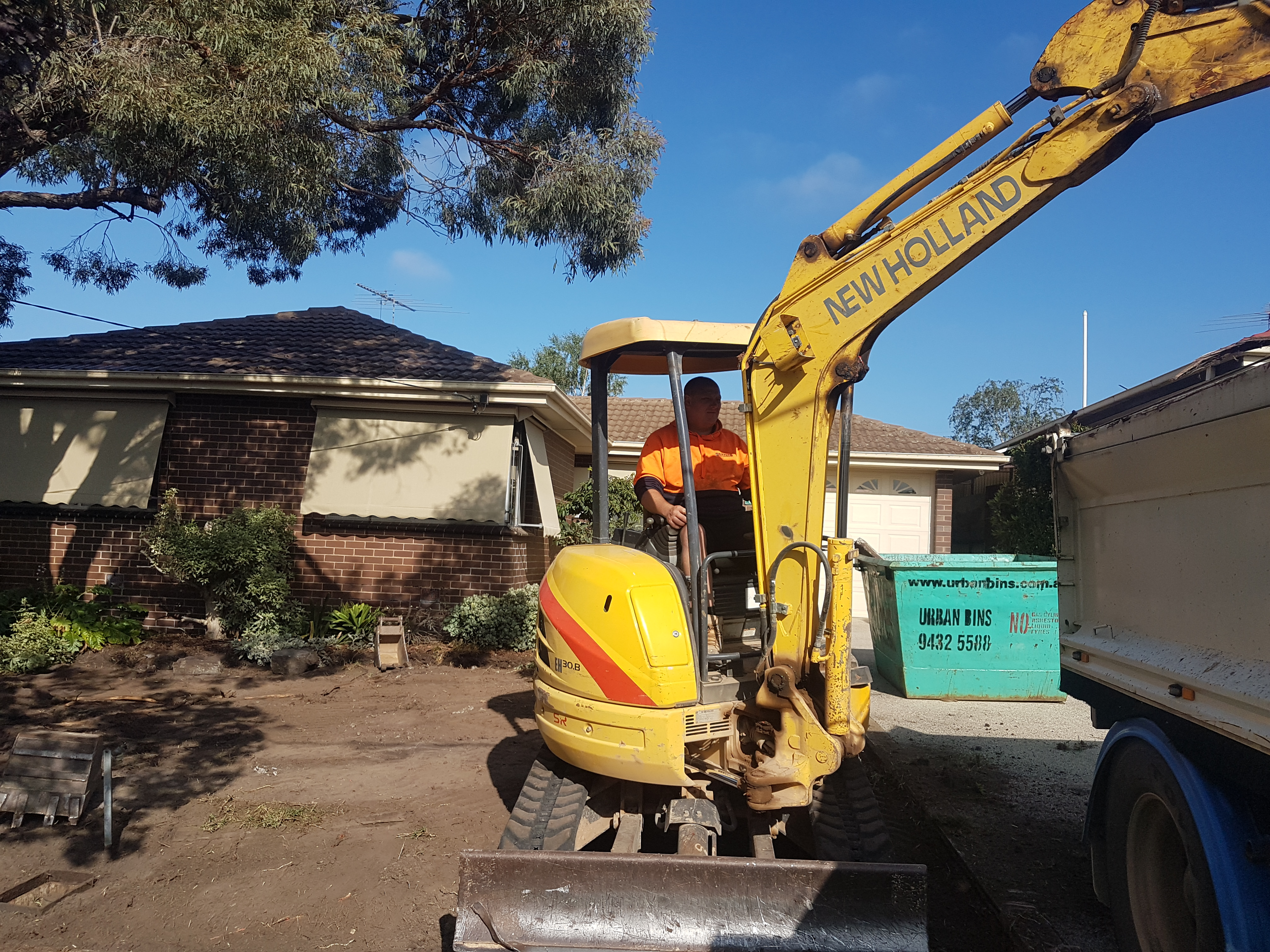Lawn removal, excurvator, loading truck, garden make over