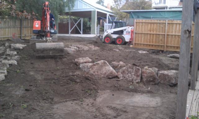 Colac rock for retaining, Terraced garden, Ivanhoe garden, Excurvator rock placement, Bobcat rock placement.
