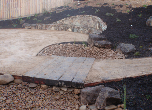 Dry creek bed to catch excess rain, drainage for heavy down pours, garden feature