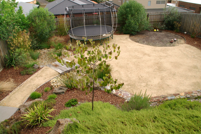 A Trampoline, Space to kick a ball around, Naive garden, low maintenance, veggie bed