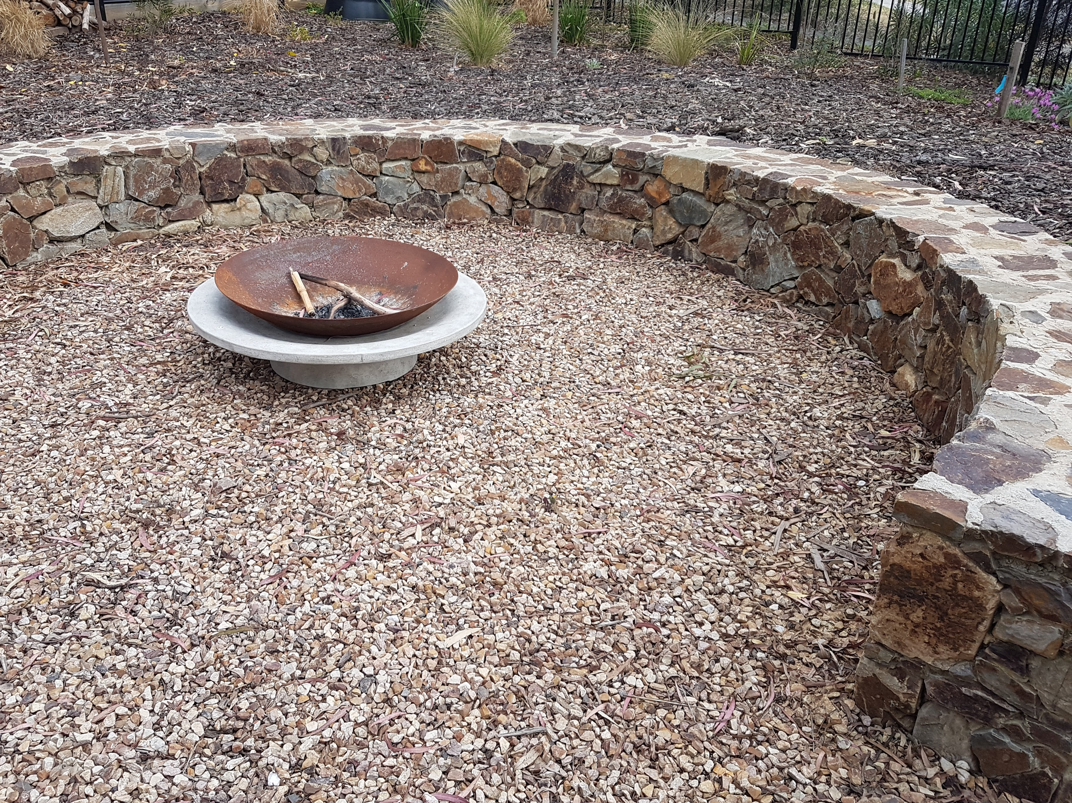 Circular seat, Fire pit, Coldstream stone, seat, Circular stone seat, metal fire pit.