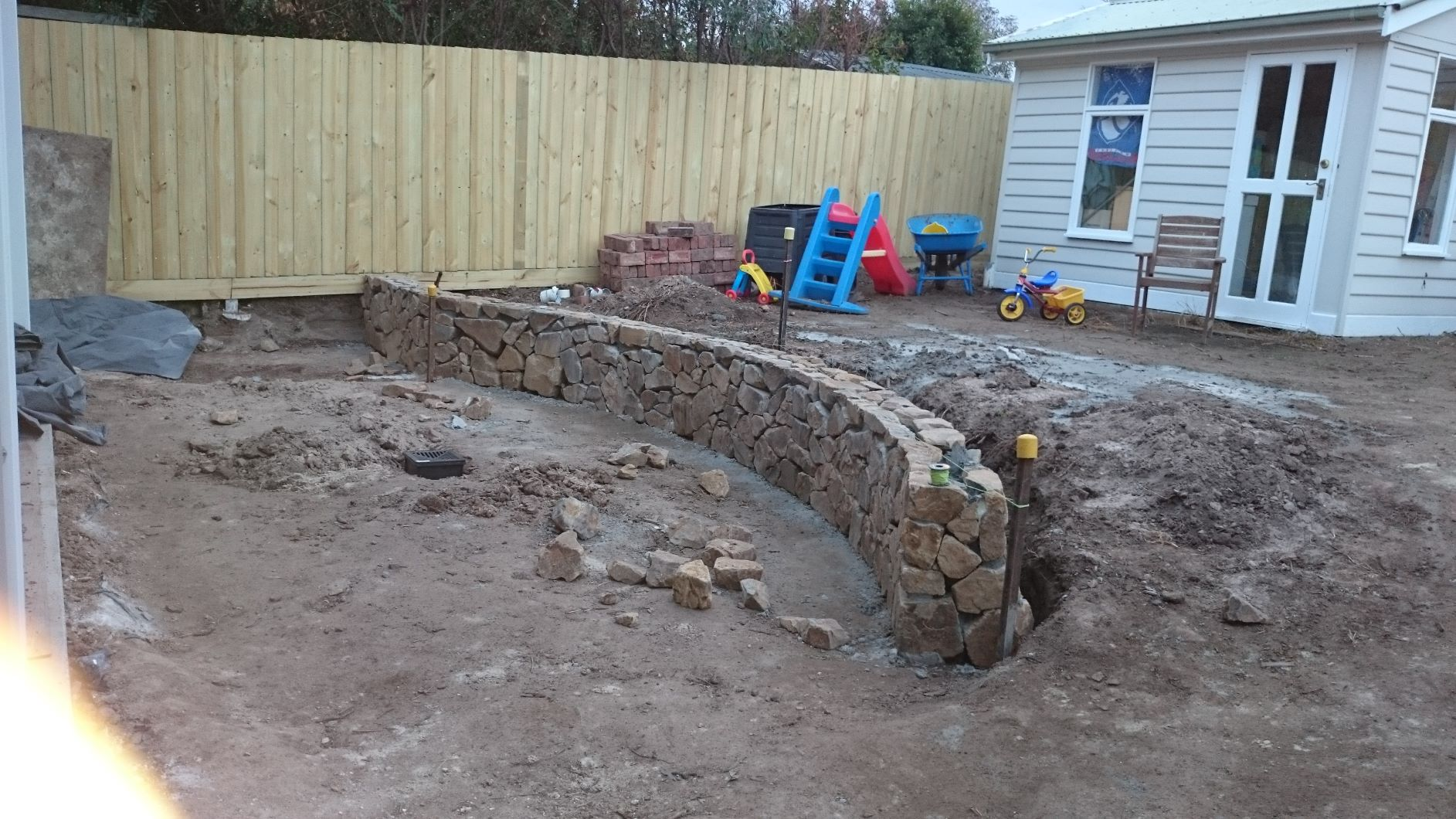 Reservior back garden, Coldstream stone retaining wall, Curved Coldstream stone seat, Cute garde shed
