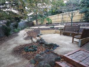 Low maintenance garden, windy pathways, seating area, Clothes line