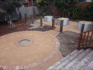Country / Rustic style garden, Garden designed for kids, garden for chooks, veggie garden, Compacted Crushed sandstone, Corrigated Iron veggie beds, Up right railway sleepers, second hand red bricks, overwrought gate,.